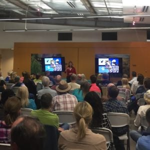 Birding enthusiast Cindy Marple giving a talk in front of an audience at the Rio Salado Audubon Center